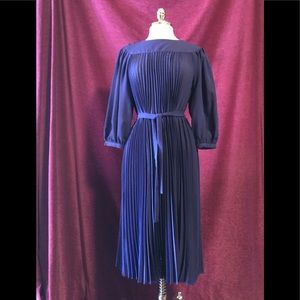 Purple, pleated vintage dress.